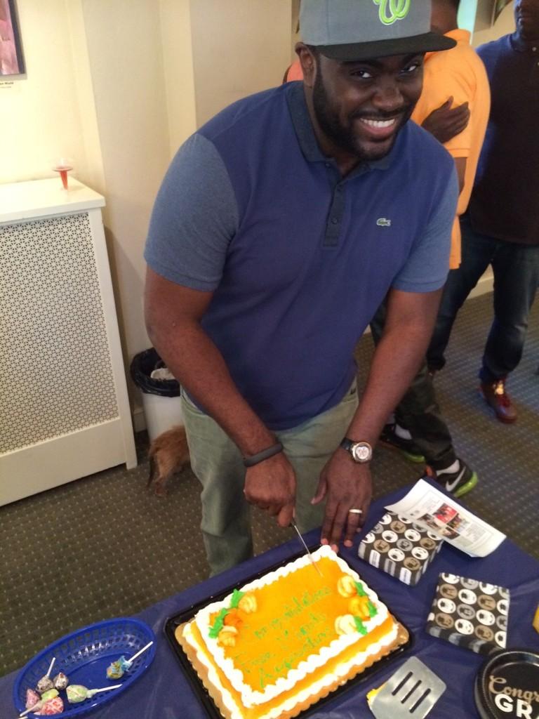 Marcus Bullock cuts cake at Apprenticeship grad!