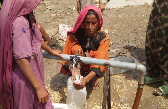 Pakistani Woman Receiving Clean Water