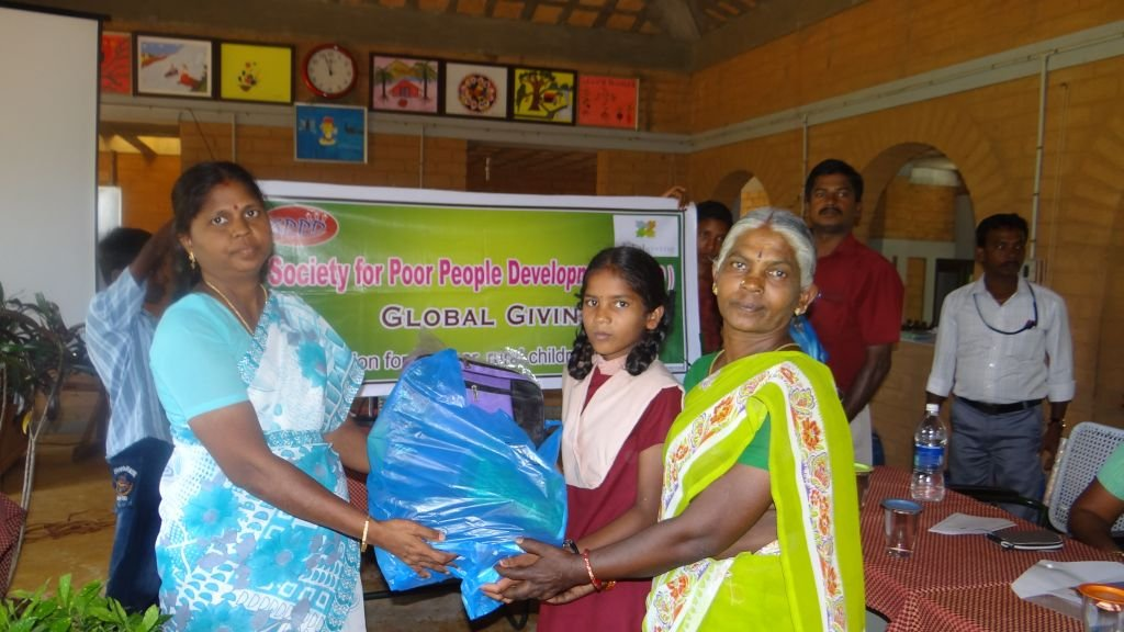 Students receiving their educational kit
