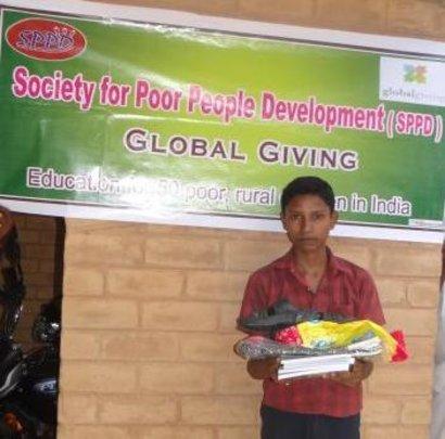 J.Rajkumar receiving his educational materials
