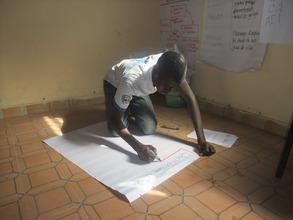 Salihou prepares his presentation
