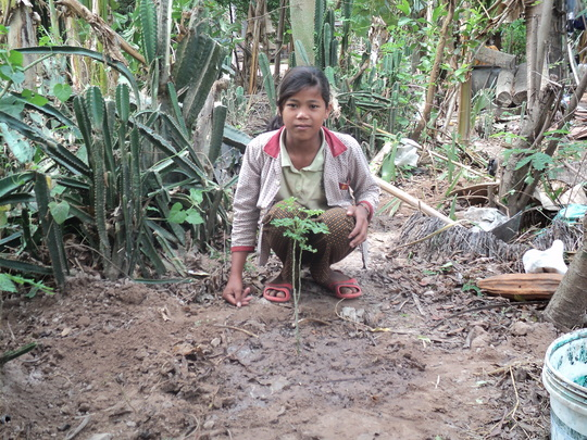 A villager with her new Moringa tree