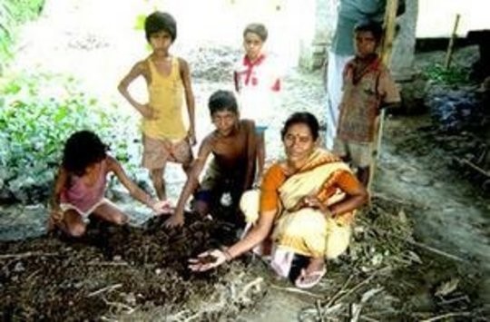 Manavi member demonstrating vermi-compost