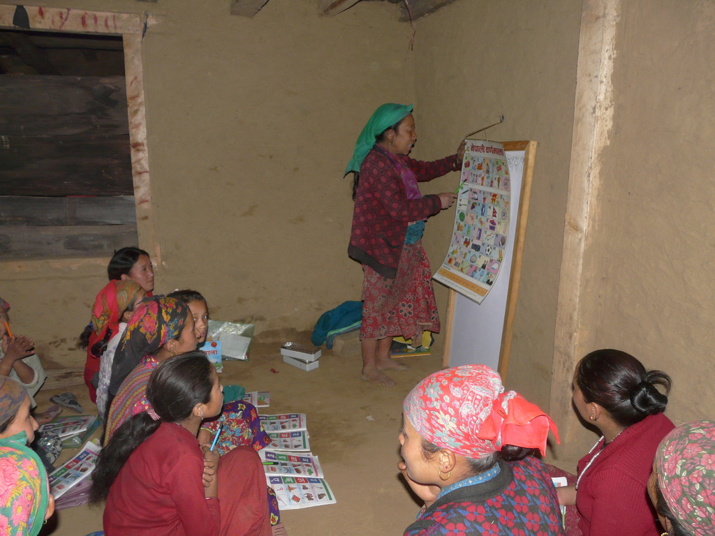 Village women  trying to write