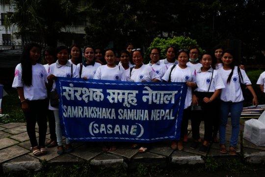 Survivor girls in women's day rally.jpg