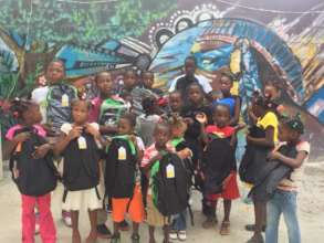 Some of the kids showing off the school bags