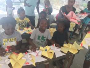 The kids also learn how to make paper decorations