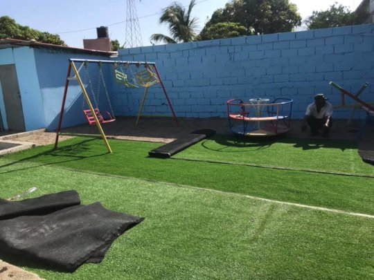 Artificial grass can be moved with the orphanage