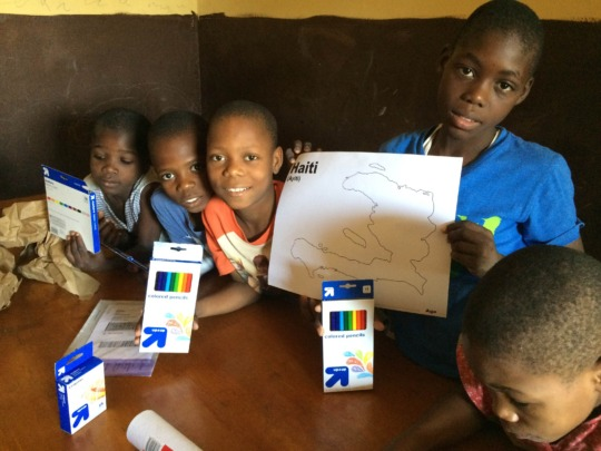 The kids have created designs for Haitian t-shirts