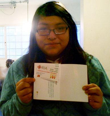 Miriam receiving her scholarship