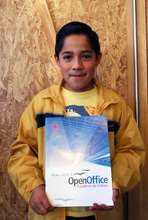 Student with OpenOffice Workbook