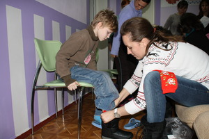 A boy is fitted with new boots