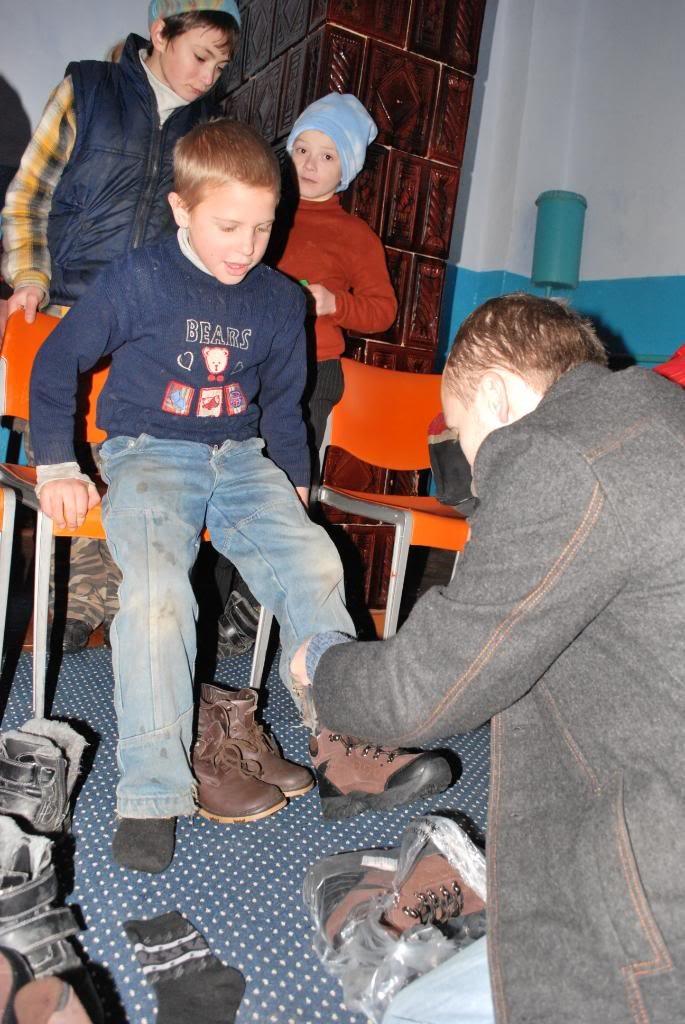 An orphan receiving boots