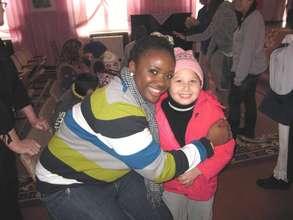 Mission volunteer dotes on little girl