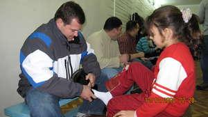 CERI Volunteers Fit Boots to Children's Feet