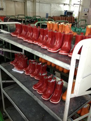 Rack of children's boots at Moldovan shoe factory