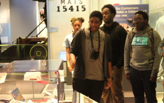 Max, a HS junior, leads peers on a museum tour