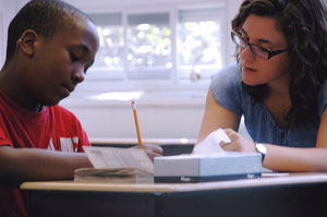 Inspired Teaching Fellow Gabby Tucci helping a student