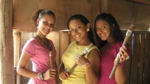 Girls pose with handmade horsehair paintbrushes