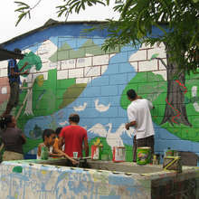 Youth paint mural in Tacualtuzte