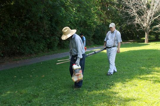Mitch carries supplies to the garden plot