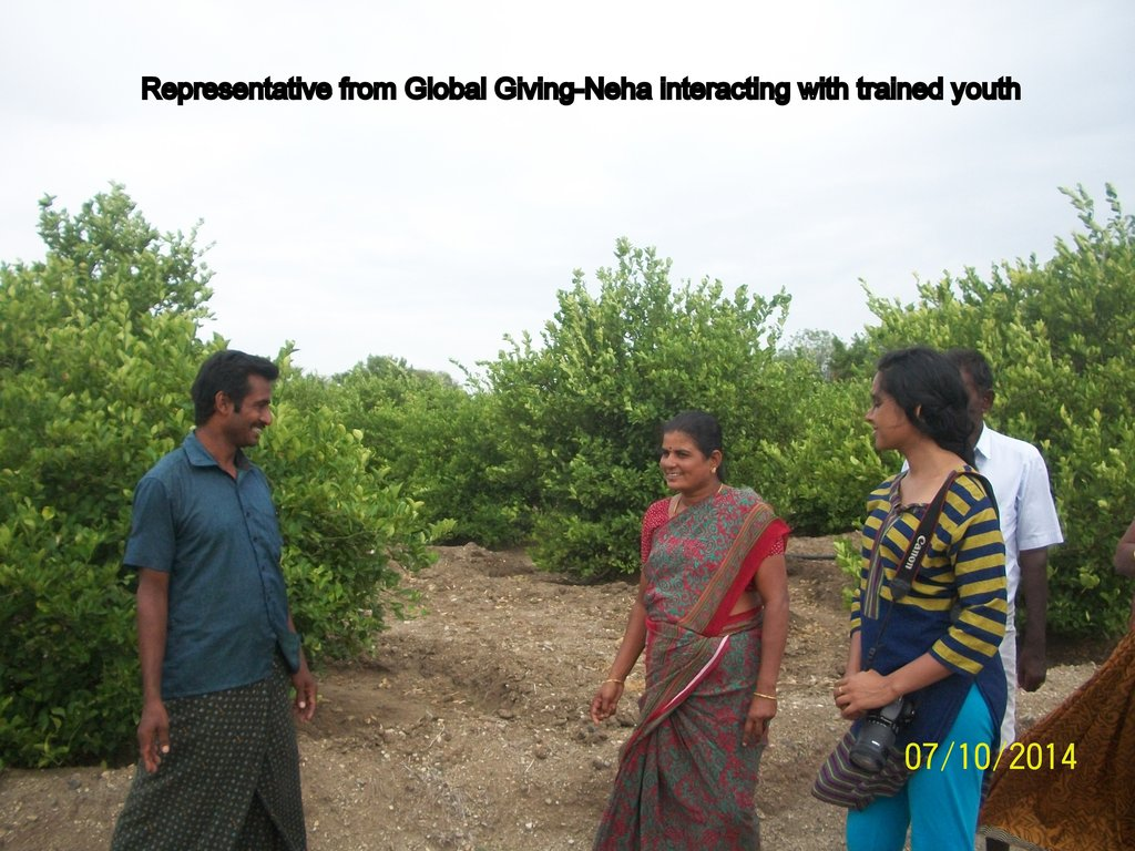 Global Giving Rep interacting with trained Youth