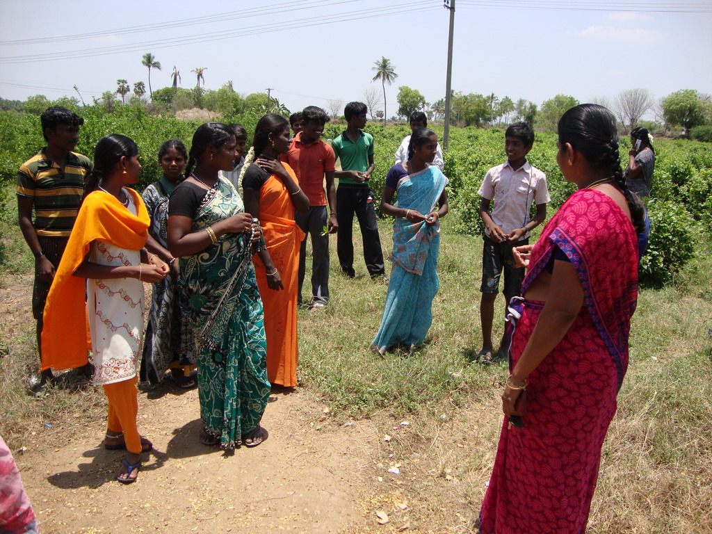 Mrs. R. Kavitha with youth in Farm Fields