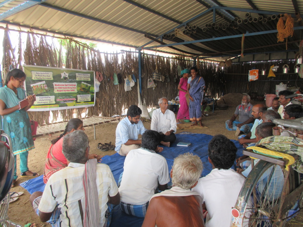 Farmers interact with Global Giving representative