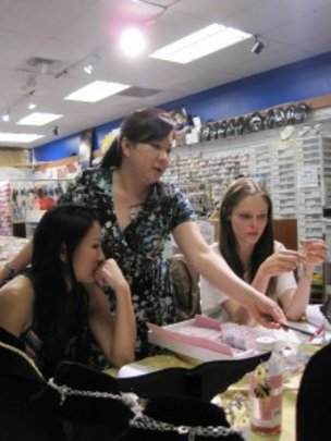 Lisa, Jenny, and Coco working on the designs.