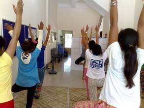 Practicing yoga!