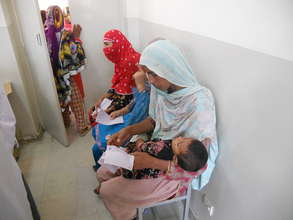 Mothers waiting at the FMH Relief Camp