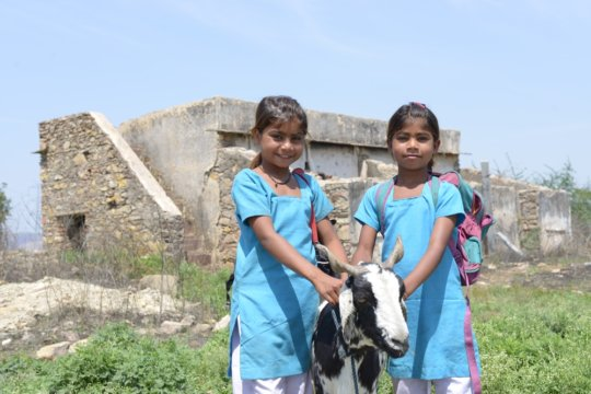 Aarti and Vidhi in their school uniforms