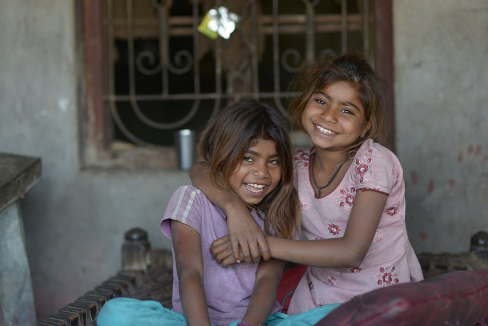 Aarti (10) and Vidhi (8) live in Rajasthan, India
