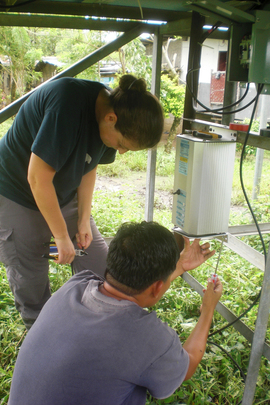 Carlo and Diana installing new inverter