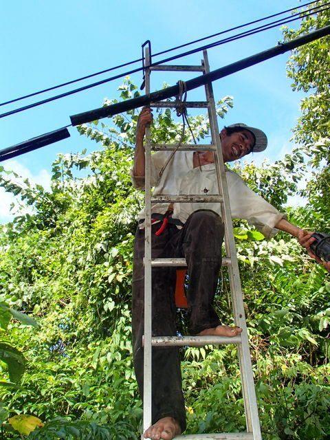 Paang Bundok resident Boy repairing a leak