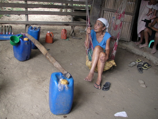 Nanay, elderly woman, with water fetching pails