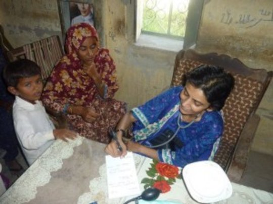 Doctor treating patient during free medical camp