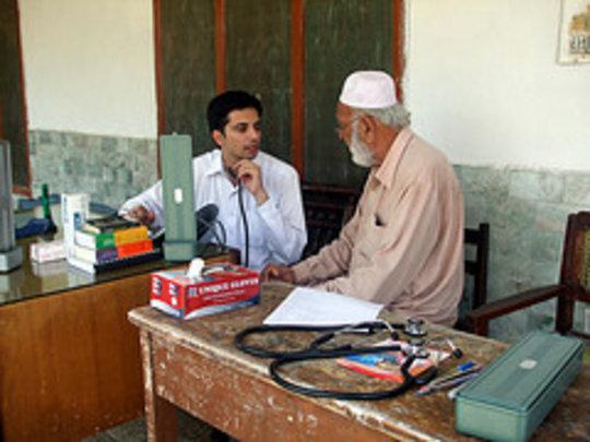 Doctor Qasim treating patient