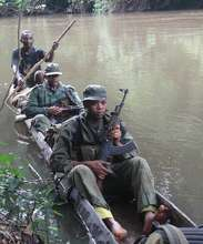 ICCN Guards Patrolling by the Reserve by Boat
