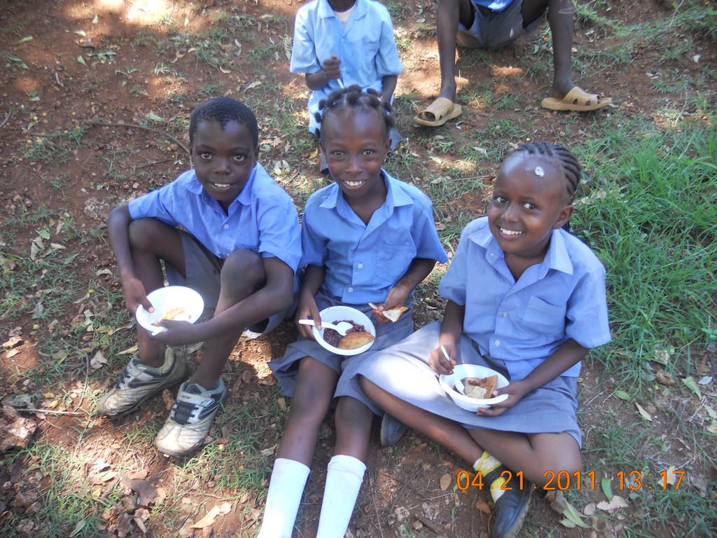 Children in Kenya with school lunches
