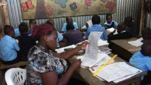 Madame Joanne teaching Standard 2