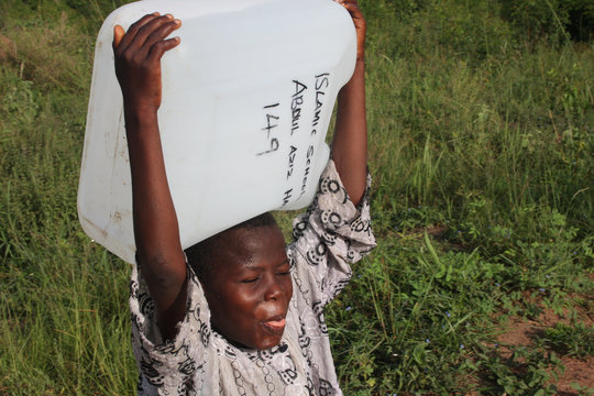 Boy Carrying Safe Water in Ghana