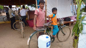 Father and Son Bring Home Clean Water