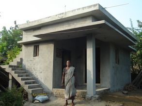 Beneficiary with newly constructed house