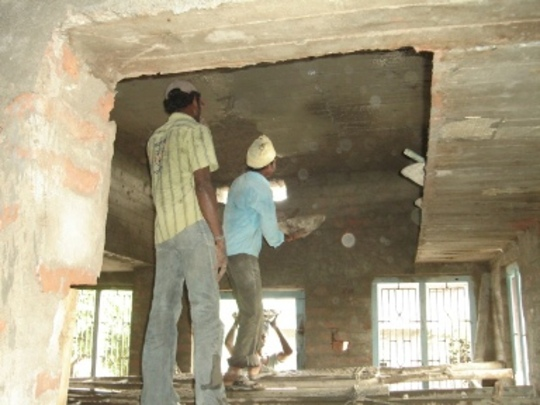 Masonry work is being done inside the house