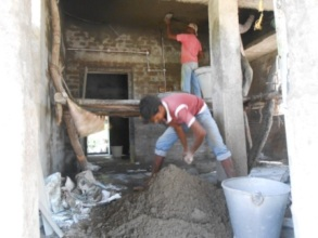 Cement concrete is being mixed for Masonry work