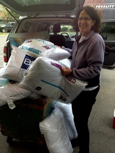 Founder Roz with a huge donation of new pillows
