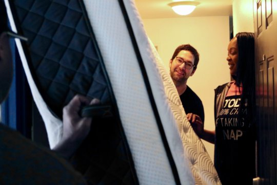 Warehouse staff deliver beds for Ramona's family