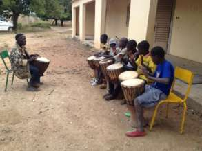 Beginners with djembe teacher Modibo Traore