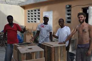 Youths and volunteers on a trash can project